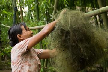 A-Burma-Woman-Unraveling-Fishing-Nets