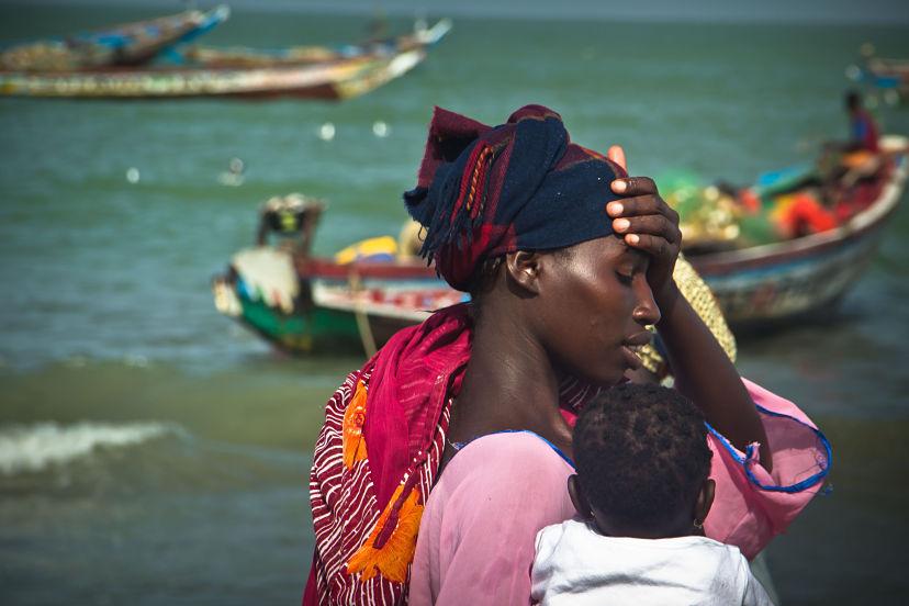 Gambia, Woman and child at Tanji Fish Market