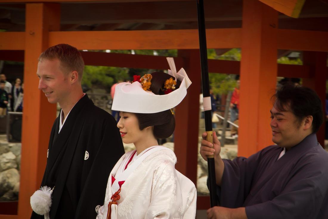 Bride and Groom Walking at the Itsukushima Shrine
