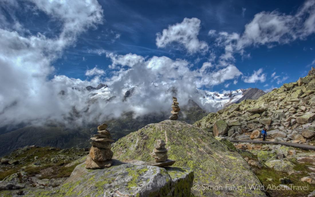 Stacked Stones Along the Hiking Path, Aletsch Wallpaper - Cover